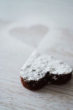 heart shaped brownie with powdered sugar