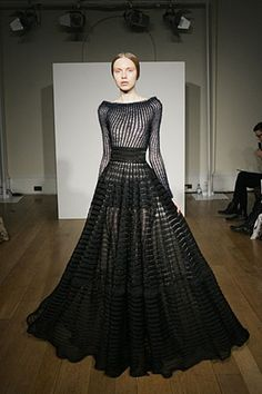 so so amazing.  knitted stripes hugging the bodice.