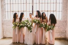 Bridesmaids in pink dresses with lush bouquets