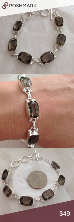 % smoky topaz 925 Sterling silver bracelet  Gorgeous, % smoky Topaz faceted gem stone adorned % 925 Sterling silver adjustable length from 6.5 to 8 inches with toggle clasp..beautiful sparkle & shine, hand made, excellent quality  NWOT ..come in jewelry gift box Hand made Jewelry Bracelets