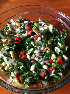 Kickin' Kale Salad: cannelli beans, artichoke hearts, black olives and lots of other add in options!  itsallconnectedliving.com