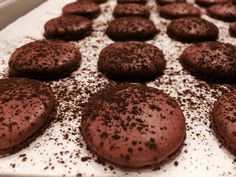 Chocolate Macaron Shells dusted with Cocoa.