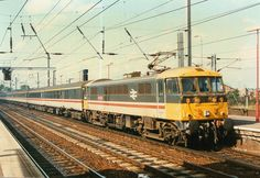 Inter-City liveried 86214 hauls a matching rake of Inter-City liveried stock into Ipswich , with a lunch time working to the capital . Locomotive Engine, Electric Locomotive, Diesel Locomotive, Third Rail, Electric Train Sets, Network Rail, Liverpool Street, Train Service