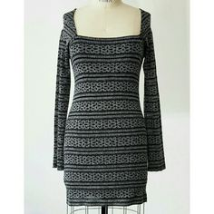 Free People Lace Knit dress Free People Lace Knit dress in black and silver.  Criss-cross detail at back. Bodice is fully lined to hem (sleeves not lined). Free People Dresses Long Sleeve