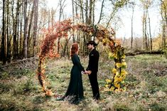 a round fall wedding arch fully done with red, yellow and brown leaves for a fal. a round fall wedding arch fully done with red, yellow and brown leaves for a fall woodland wedding. Fall Wedding Arches, Wedding Ceremony Backdrop, Fall Wedding Dresses, Autumn Wedding, Wedding Backdrops, Wedding Photography Packages, White Photography, Baltimore Wedding, Wedding Photos