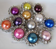 I love, love, love these buttons. They would be perfect for finishing my kumihimo bracelets :)