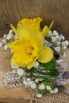 Wrist corsage with yellow daffodils, baby breath [gypsophila], lace & burlap for the Victorian/farm style. Created by Judith Marie at Fox Bros Floral, Hartland, WI