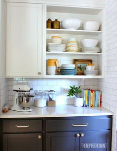 Open shelves with functional decor in baking center. Neutral paint colors (charcoal and white) with pops of color!