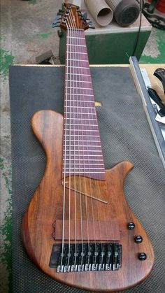 Beautiful 9 String bass with a Kahler fixed bridge built for Andres Cervantes by HJC Customs