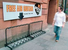 In a hilarious bit of guerilla marketing, radio station Rock in Glasgow, Scotland set up an empty guitar rack with a sign above it reading 'Free Air Guitar – Please Take One. Guerilla Marketing, Street Marketing, Marketing Viral, Marketing Ideas, Experiential Marketing, Internet Marketing, Event Marketing, Marketing Strategies, Facebook Marketing