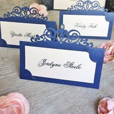 Loving these navy laser engraved escort cards! See more here: http://paperandlaceboutique.com/