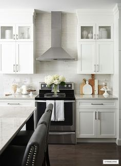 White kitchen cabinets, stainless steel vent hood, brushed silver hardware. #whitekitchen #kitchenhardware #kitchencabinets #kitchenupdate #kitchenbacksplash #kitchendecor Country Kitchen Inspiration, Kitchen Renovation Inspiration, Kitchen Interior, Kitchen Design, Kitchen Decor, Kitchen Layout, Kitchen Ideas, All White Kitchen, White Kitchen Cabinets
