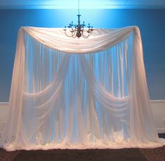 Elegant wedding ceremony backdrop - we'll want some type of simple fabric draping behind where we'll say our vows so the pics will have nice background. The fabric draping does not have to be this elaborate at all & maybe a color (that's not dark) would be nice- not sure