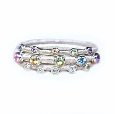 stacking rainbow rings with aquamarine, peridot, citrine, pink tourmaline and amethyst Peridot, Amethyst, Silver Ear Cuff, Big Rings, Pink Tourmaline, Stacking Rings, Beautiful Rings, Spring Time, Sterling Silver Rings