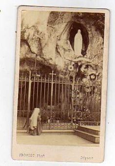 St. Bernadette at the Grotto in Lourdes where Our Lady appeared to her.