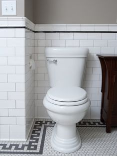 Classic subway tile with black trim detail, and I love the penny tile floor with border