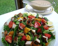 BLT CHICKEN SALAD      DRESSING:   1/2 c. mayonnaise (I use reduced fat mayonnaise)  3-4 Tbsp. barbecue sauce  2 Tbsp. finely chopped onion  1 Tbsp. fresh squeezed lemon juice  1 Tbsp. milk  1/4 tsp. black pepper    SALAD:   8 c. torn salad greens  1/2 c. sliced red onion  2 large tomatoes, chopped  1 1/2 lb. boneless, skinless chicken breasts, cooked and cubed (any leftover cooked chicken works great in this salad-leftover cooked turkey is wo