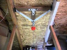 """Using a Harbor freight 880 lb winch thru a double pull """"trolley"""" making it a fast moving retractable stair system. Honestly I think it would be better to use..."""