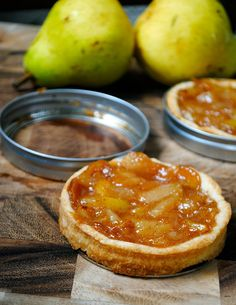 Mini Pear Tarts in Mason Jar Lids! Genius! Perfect little spring form pans so tarts & pies pop right out.