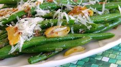 This recipe seasons green beans with shallot and garlic and then adds Parmesan cheese for a great side dish suitable for Thanksgiving dinner.