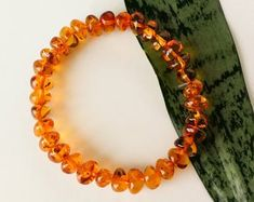 Baltic Amber Jewelry: Natural Amber Necklaces by AmberByTorvela Amber Bracelet, Amber Necklace, Beaded Necklace, Beaded Bracelets, Necklaces, Brown Gemstone, Baltic Amber Jewelry, Honey Colour, Amber Beads