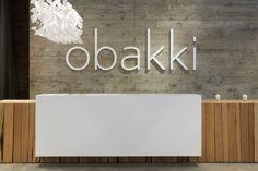 reception desk -- Obakki, Vancouver : Modern store interior designed by mcfarlane Office Reception Design, Hotel Reception, Reception Areas, Reception Desks, Reception Counter, Reception Signs, Lobby Design, Lobby Interior, Office Interior Design