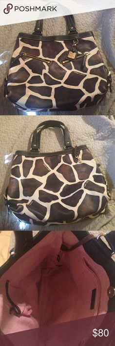 Dooney $ Bourke giraffe print Mint condition 13x12. Authentic. Clean inside and out Dooney & Bourke Bags