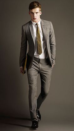 Fantastic tie color with slate grey suit.