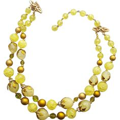 Summery, 1960s vintage bead necklace in lemon and gold and green crystal beads by Deauville. Measurements are adjustable from 13 - 15 inches with a