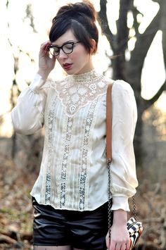 her blouse! but worn differently - tucked into a high-waisted skirt, with sleeves rolled up.