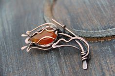 """Shawl pin, scarf pin, brooch, sweater pin, cardigan clasp, oxidized copper and carnelian wire wrapped shawl pin """"Flower of fire"""" by Keepandcherish on Etsy"""