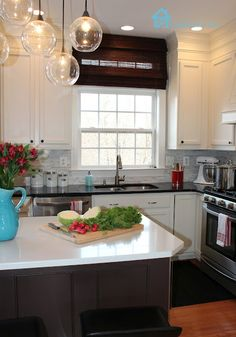 Awesome DIY kitchen remodel. Check out the light fixture!----this is our kitchen before!  Must save this for inspiration.