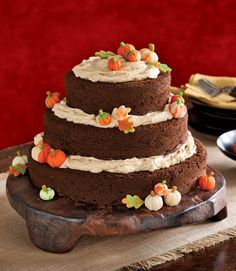This towering pumpkin patch begins as three cakes in graduated sizes, with three generous layers of buttercream that escape temptingly toward the tiers' edges.