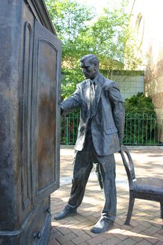 The statue of C.S. Lewis in front of the wardrobe from his book The Lion, the Witch and the Wardrobe in East Belfast, Northern Ireland