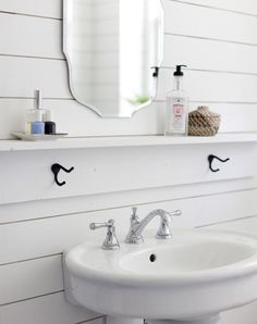 Help! My small sink offers zero counter space for things like toothbrushes, let alone decor. Try add... - A Beautiful Mess