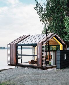 Pavilion overlooking the shores of Puget Sound on Vashon Island, about 20 miles southwest of Seattle. Standing-seam copper siding accentuates sections of the structure that provide shear support for the steel moment frame. Vashon Island, Modern Garage, Exterior Design, Design Garage, Interior Architecture, Tiny House, Mcm House, House Wall, Cottages