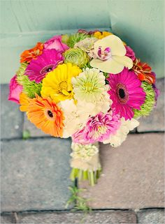 Bright mixed daisy bouquet. Captured By: Bokeh Love Photography #wchappyhour http://www.weddingchicks.com/2014/06/18/wedding-chicks-happy-hour-18/