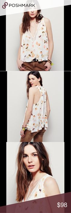 🦄$35 TODAY🦄FREE PEOPLE printed swing tank top In an oversized, swingy silhouette this printed top features a fly-away back and V-neckline. Lace trim and dropped armholes. 2520455  Retail: $88 Size: L  ❤I have over 300 new with tag Free People items for sale! I love to offer bundle discounts!  ❤No trades. love the item but not the price? Submit an offer! Free People Tops Tank Tops