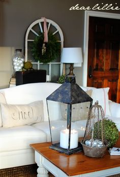 Coffee table decor... love the lantern idea.
