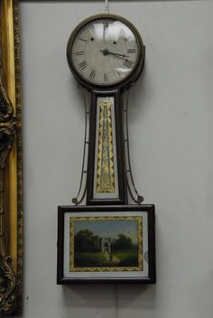 Lot Details – Nadeau's Auction GalleryDescription: Weight driven banjo clock with painted glass throat panel and reverse painted door, probably Massachusetts. Provenance: West Hartford Estate.  Dimensions: dia. 28 1/2in.  Estimate: $400 - $800