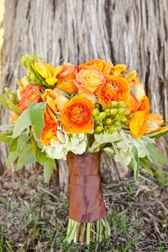 Pretty flowers for bridesmaids...  Maybe with some more dark fall colored flowers mixed in