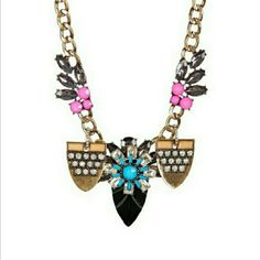Jeweled Statement Necklace Pink, blue and black offset with a burnt gold metal chain. This is great for accenting a dress, bitton-down shirt or tee. T&J Designs Jewelry Necklaces