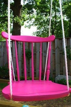 Hot pink Vintage kitchen chair repurposed into outdoor garden swing for the garden; perfect for cottage style home decor; Upcycle, recycle, salvage, diy, repurpose!  For ideas and goods shop at Estate ReSale  ReDesign, Bonita Springs, FL