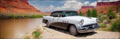 "12 x 36 inch panoramic photograph of classic white Buick Impala car on the river's shore with red mountain landscape. Image title: Buick on the River's Edge I was traveling the back roads along a river and found this beautiful classic white car. The restored Buick automobile was perched on a cliff edge with a beautiful canyon of red rock landscape background. All photographs are original and photographed by artist Bob Estrin. Print details: - 12"" x 36"" unmatted photograph on paper…"