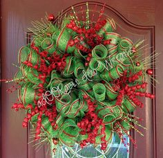 Christmas Curls and Sparkles by aDOORable Deco Wreaths. Mesh purchased from http://www.trendytree.com. For more designs please visit http://www.facebook.com/ADOORableDecoWreaths #trendytree #wreath