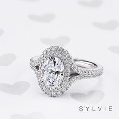 This gorgeous double halo engagement ring features a carat oval center wrapped in a double halo of round-brilliant diamonds. The outer halo tapers into the shank, creating two rows of beautiful diamonds, and the total weight is carats. Split Shank Engagement Rings, Beautiful Engagement Rings, Halo Diamond Engagement Ring, Designer Engagement Rings, Oval Engagement, Halo Rings, Thing 1, Wedding Ring Bands, Diamonds