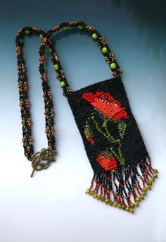 Red Poppy Flower 2011  Personal Collection  SweetBananaberry Robin organized by the talented Darcy Rosner.   I made an loomed amulet bag. Helena Tang from Singapore embellished the flower petals.   Cath Thomas from Switerzald made the fringes.  Alexandra Le Houedec from France made the straps.