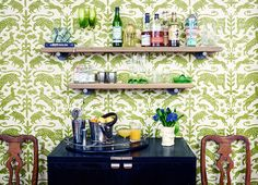 A Southern-inspired entertaining area in the kitchen of Studio Four NYC co-founder Kate Reynolds is backed by Pintura Studio's Escorial wallpaper. | Lonny.com