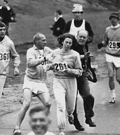 The first woman, Kathy Switzer, to run the Boston Marathon in 1967. A race official actually tried to grab her and yank her out of the race, but her friends helped her.