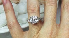 Asscher in a tapered diamond setting by David Klass Jewelry.